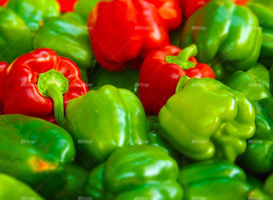 Vibrant Green and Red Bell Peppers. I photographed these bell peppers at the Farmers Market in Kansas City and added vibrance and a tilt shift effect.