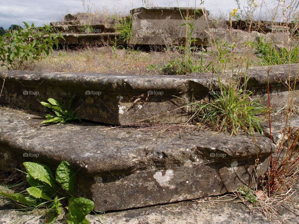 The remains of steps to an old castle on the grounds of Castle Howard in the English countryside.