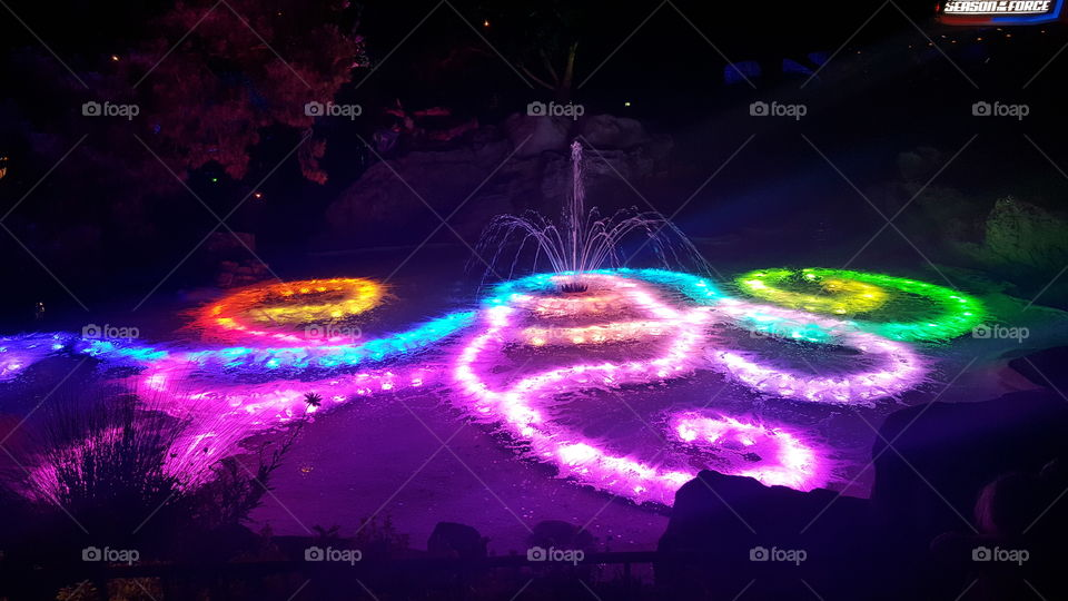 rainbow colored lights in Fountain at Disneyland