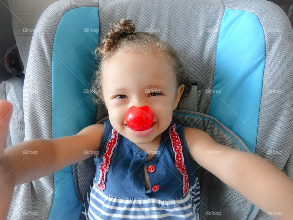 Portrait of child girl with clown nose