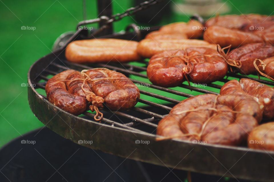 Preparation of meat on barbecue grill