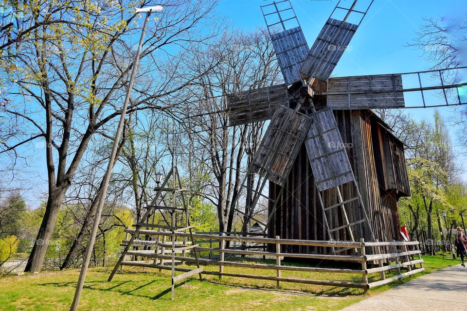 wooden windmill at national village museum in Bucharest,- Romania