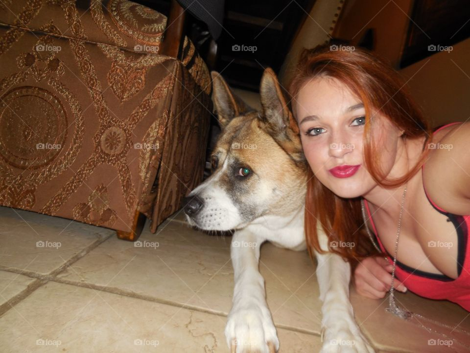 Girl being silly with dog