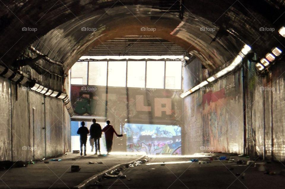 Boys in tunnel