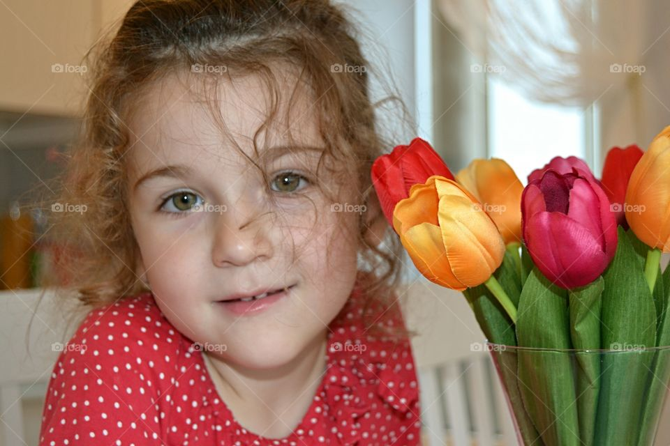 Close-up of girl holding tulip