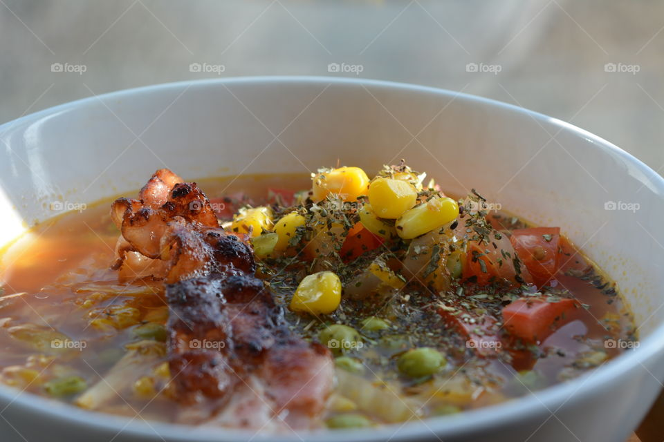 Close-up of chicken soup in bowl