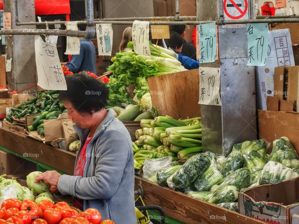 Buying Fresh Vegetables In A Chinese Grocery. Chinese Market