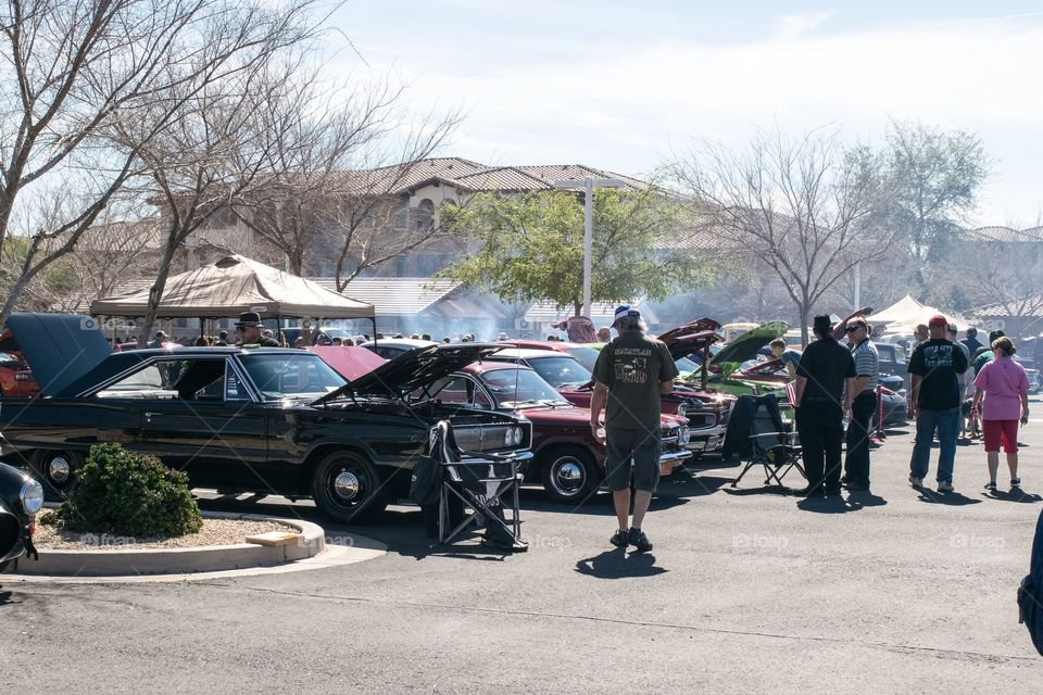 People looking at cars at the classic car show