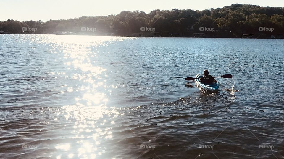 Gorgeous early morning kayak adventure for this young man turns out to be a great way to get some exercise!