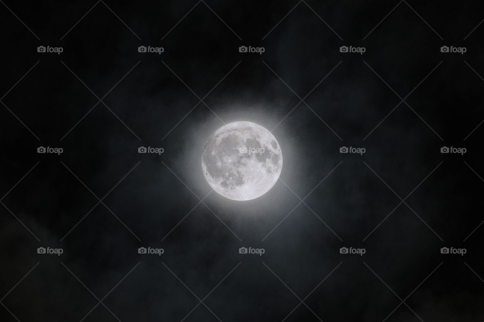 Full moon on clouds close-up