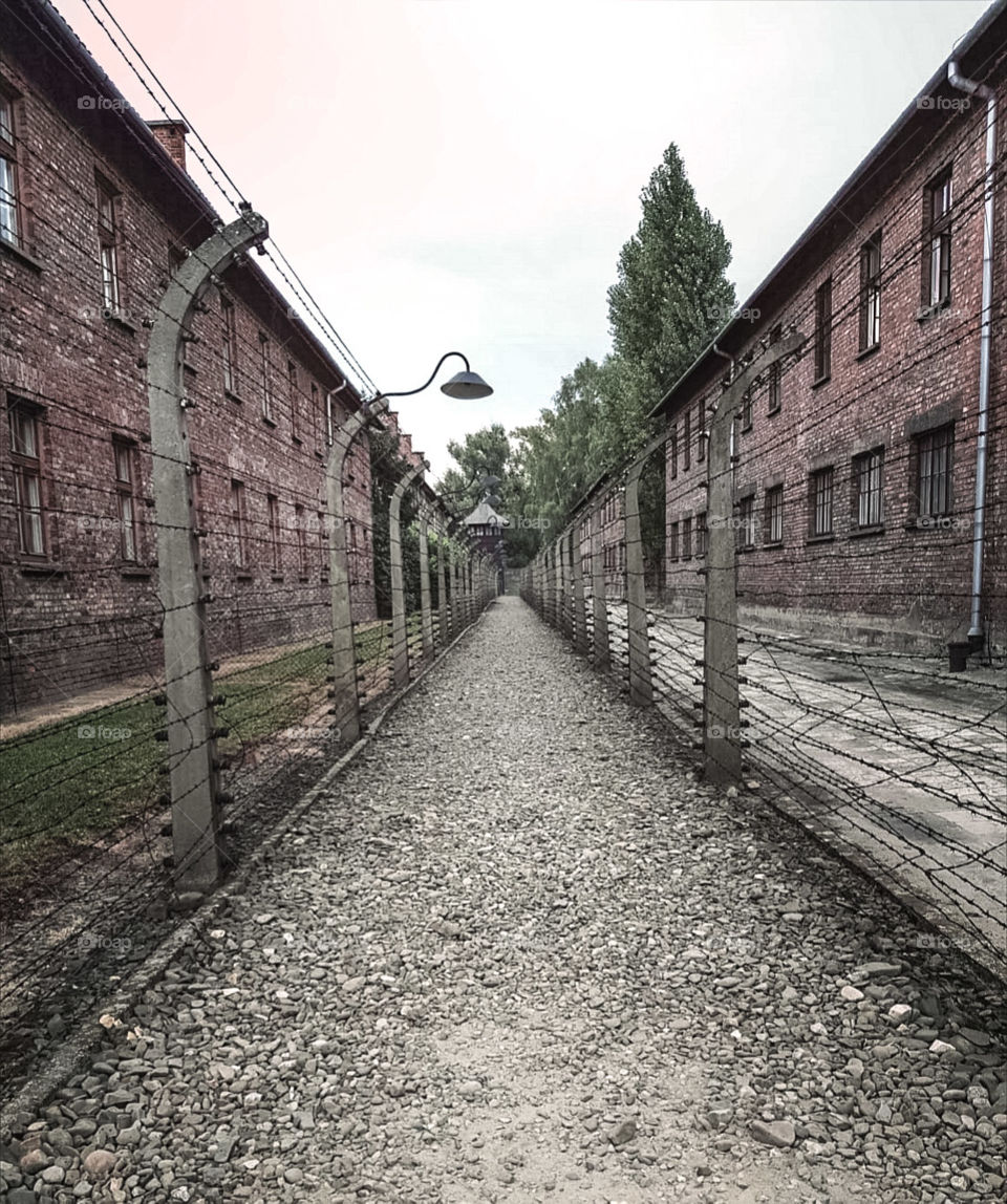 Visiting the scary Auschwitz, it gives me goosebumps every time i look at the picture