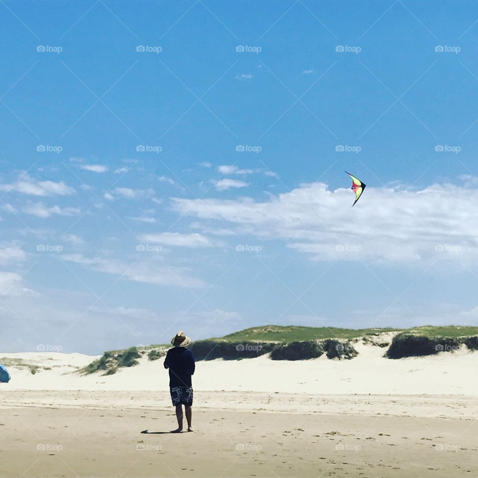 Flying a kite at the beach