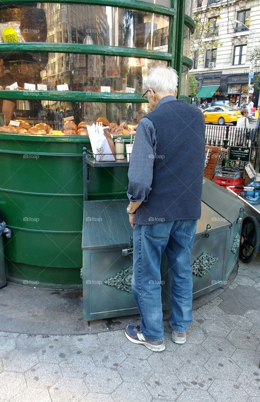 Elderly Man from Behind at an Outdoor Snack Shop