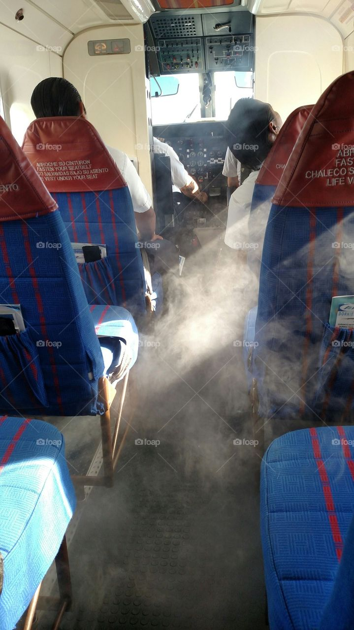 Smokin'. Condensation in the cabin gives the appearance of the plane being on fire. It was not.