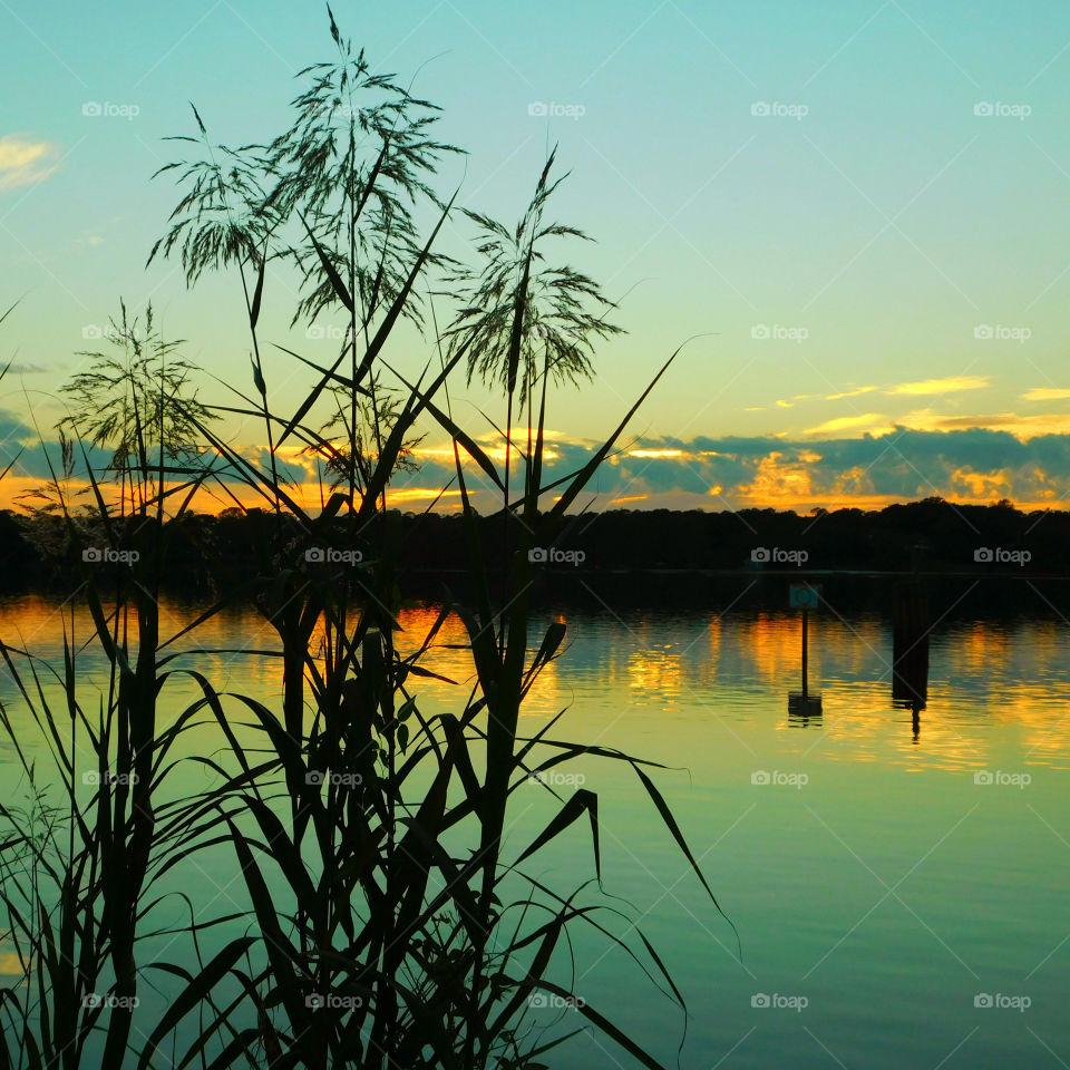 Sunset Shoreline! An elegant sunset surrounding the bayou waterway is viewed from the shoreline!