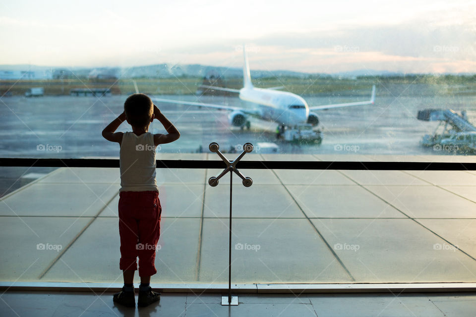 Boy standing in the airport