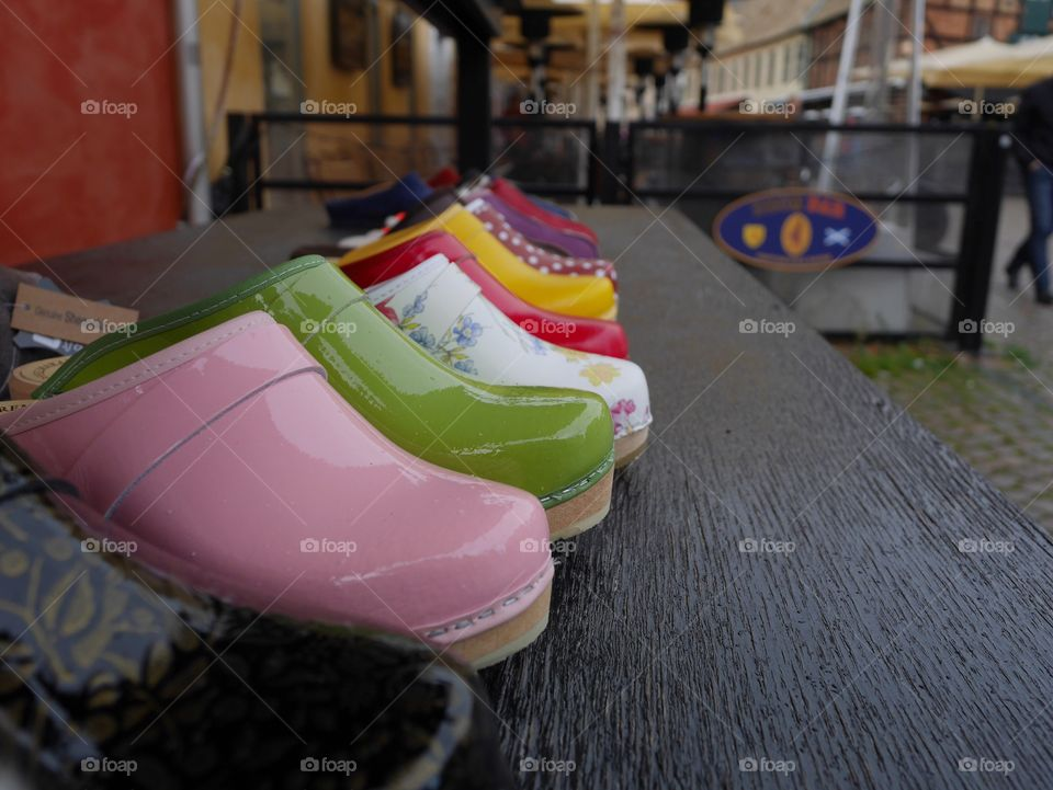 Different colored clogs on a market