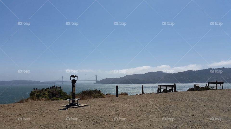 View of coin operated against golden bridge in San Francisco