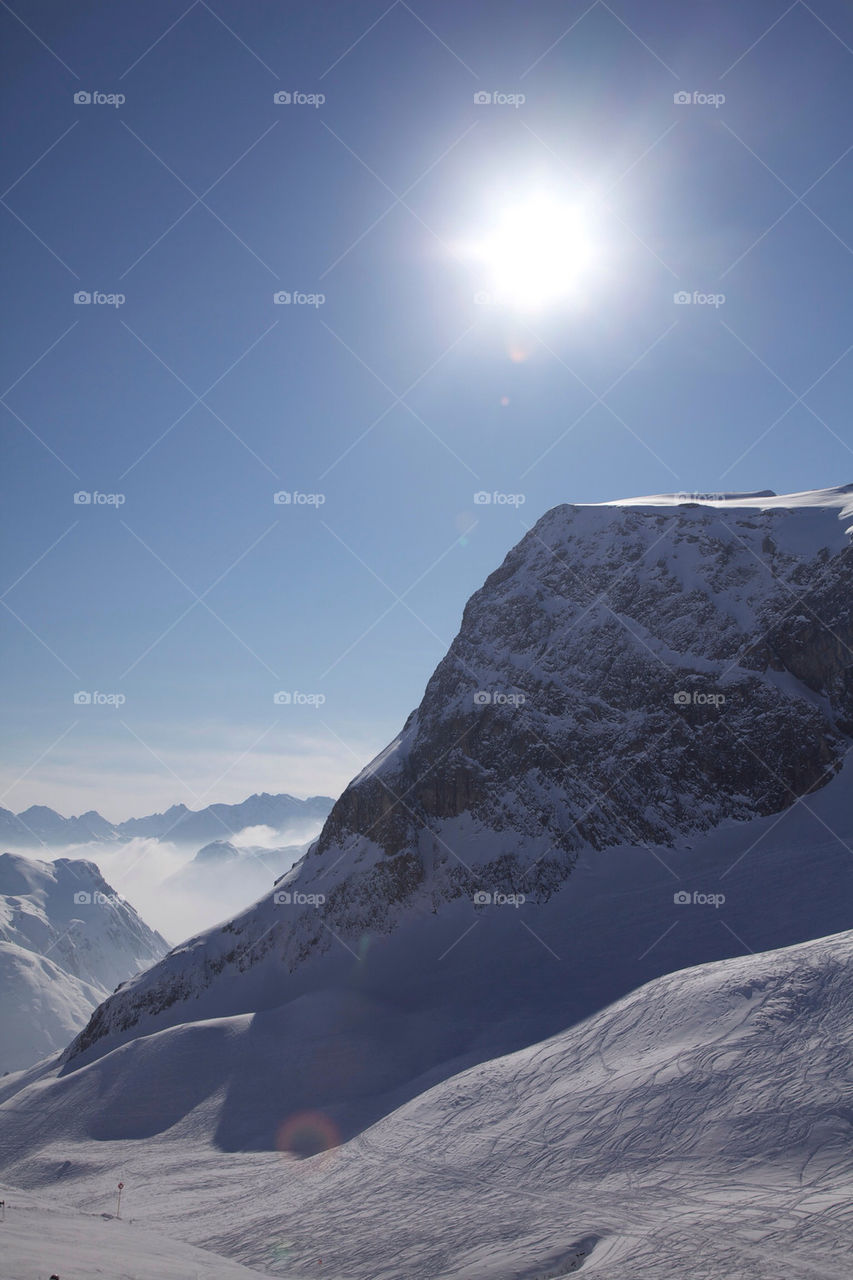 Sunlight over snowy mountains