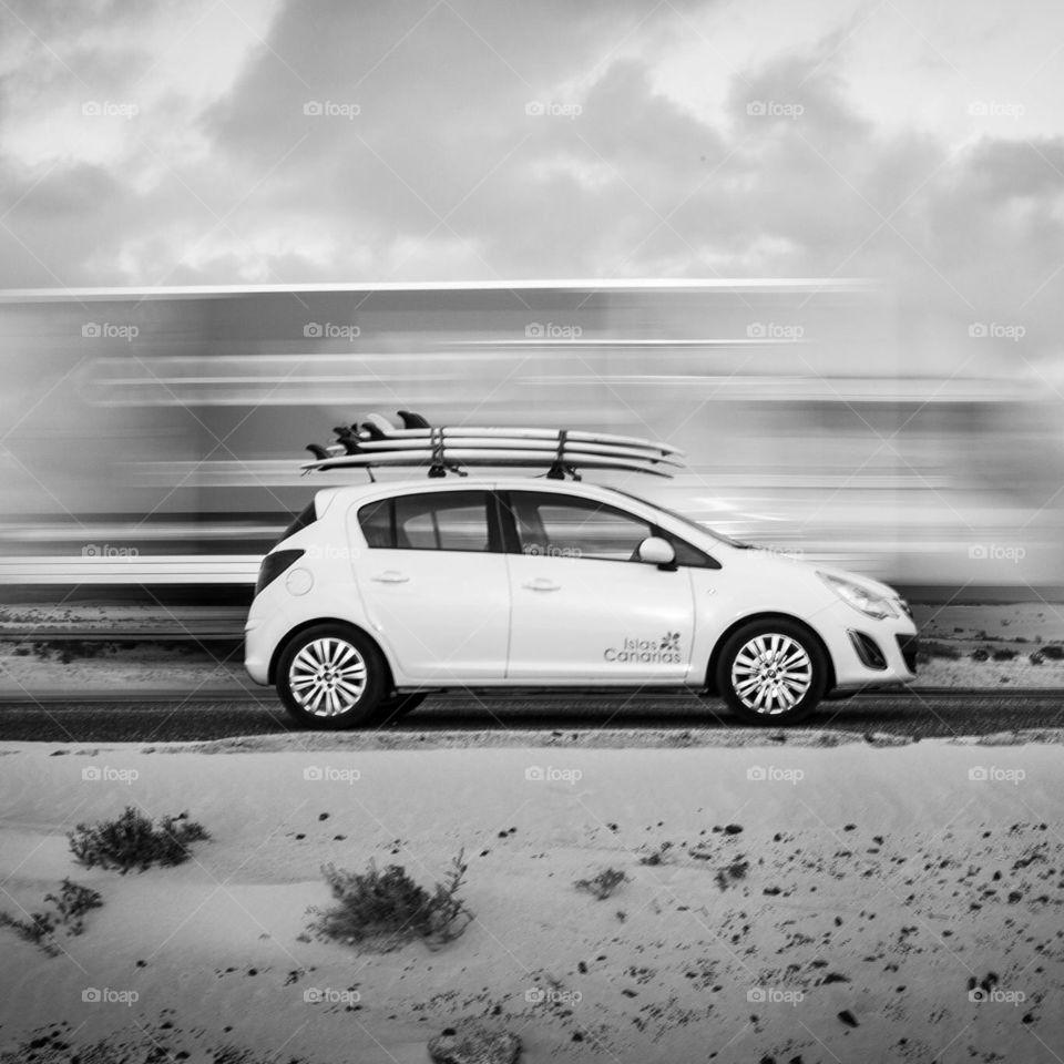 Blur. Corsa in Fuerteventura with surfboards
