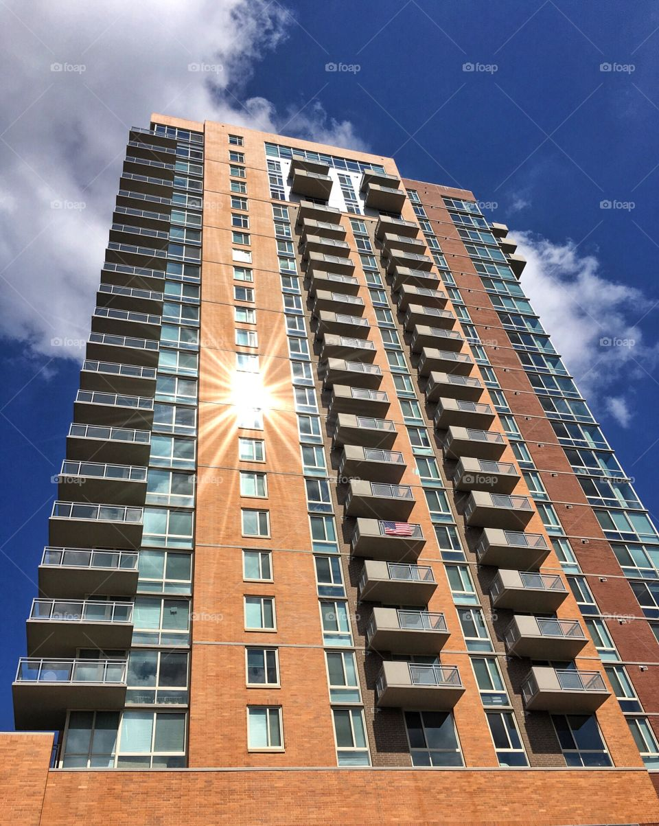 Apartment building with flag and lens flare