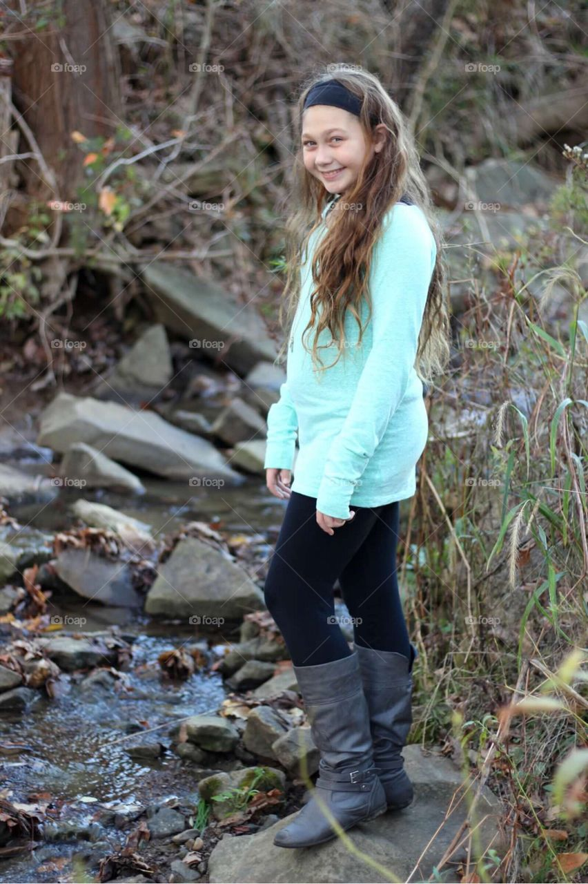My beautiful girl playing in a stream.