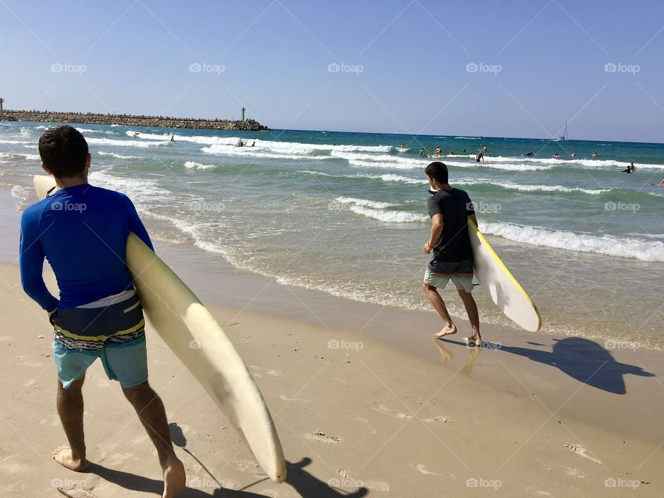 Two guys going surfing