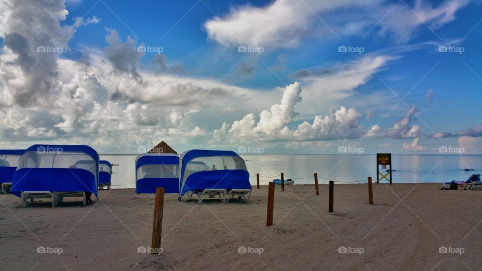 Beautiful early morning views..I ocean looks like ice and clouds with cabana.. Coco cay Bahama's