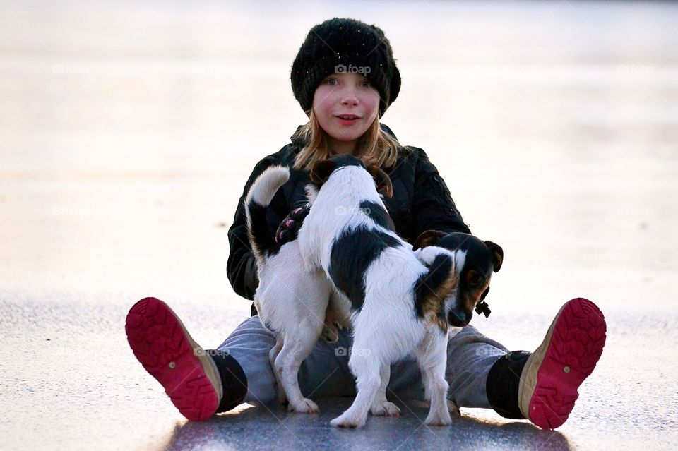 Girl playing with cute puppies