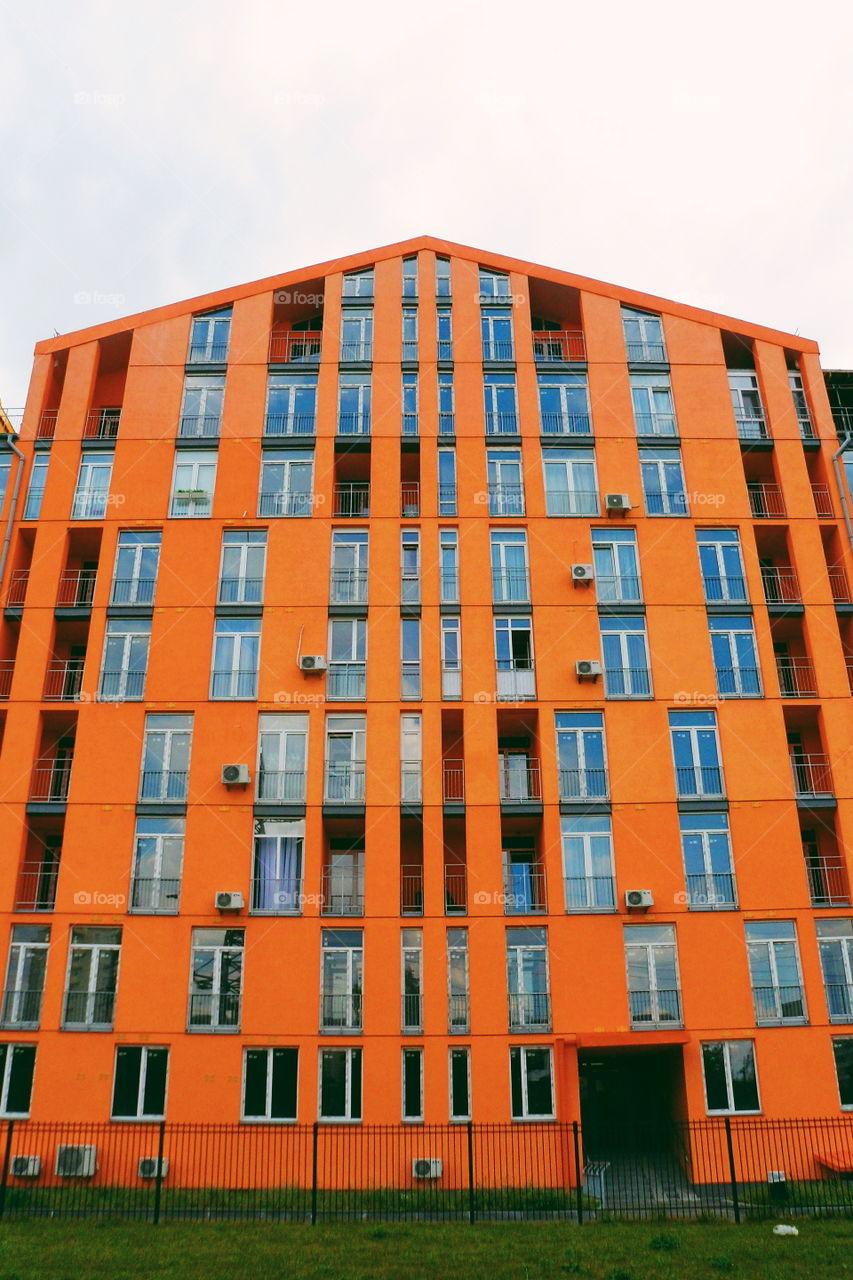 Orange facade of the building