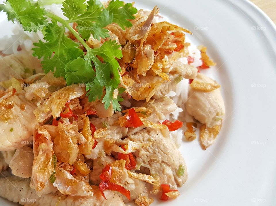 Stir-Fried Chicken with Garlic Pepper, Crispy chili and garlic on top. - top view