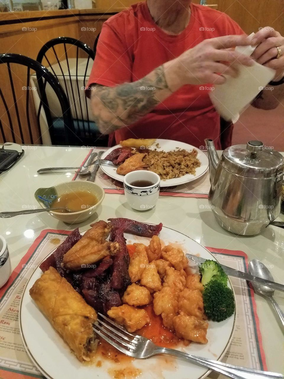 Chinese food for each of us. Rice, spare ribs, egg roll, wings, sweet sauce, tea.