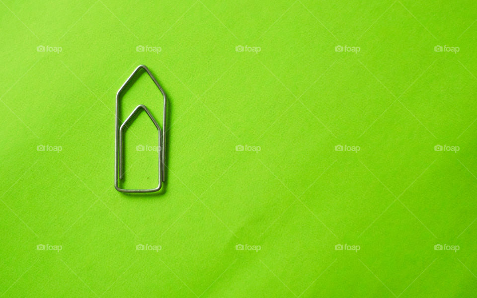 Paperclip on green background