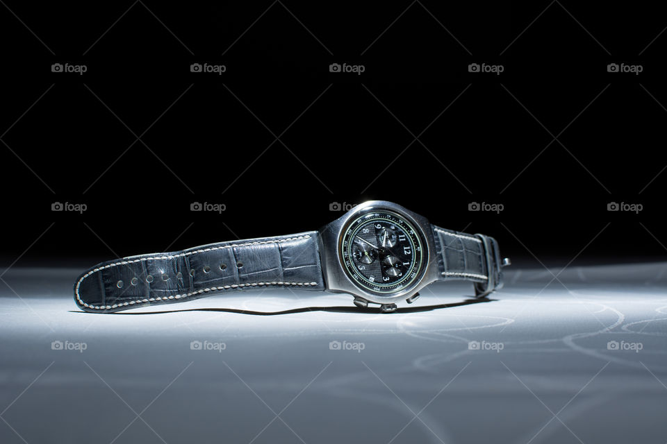 modern handwatch on the table. Men's wristwatch