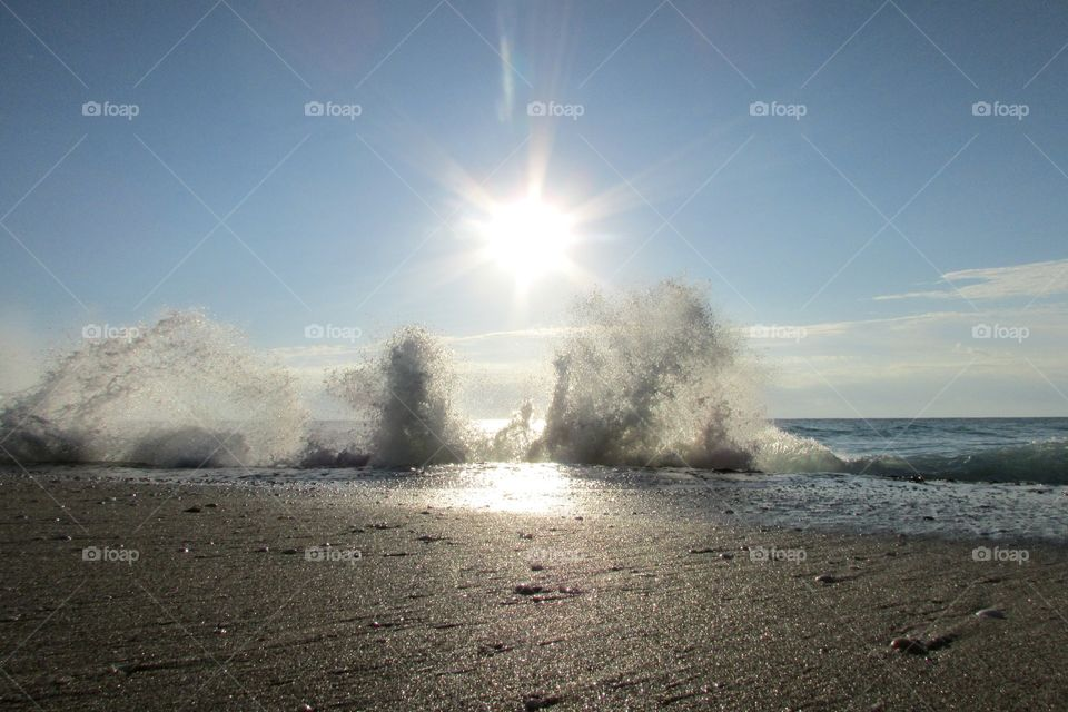 Amazing view of waves crashing against rocks at the beach in singer island Florida!