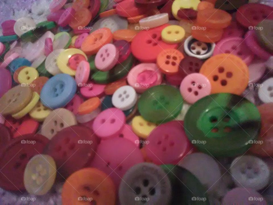 so many beautiful , colorful and bright buttons that will bring a smile to your face with all that color.