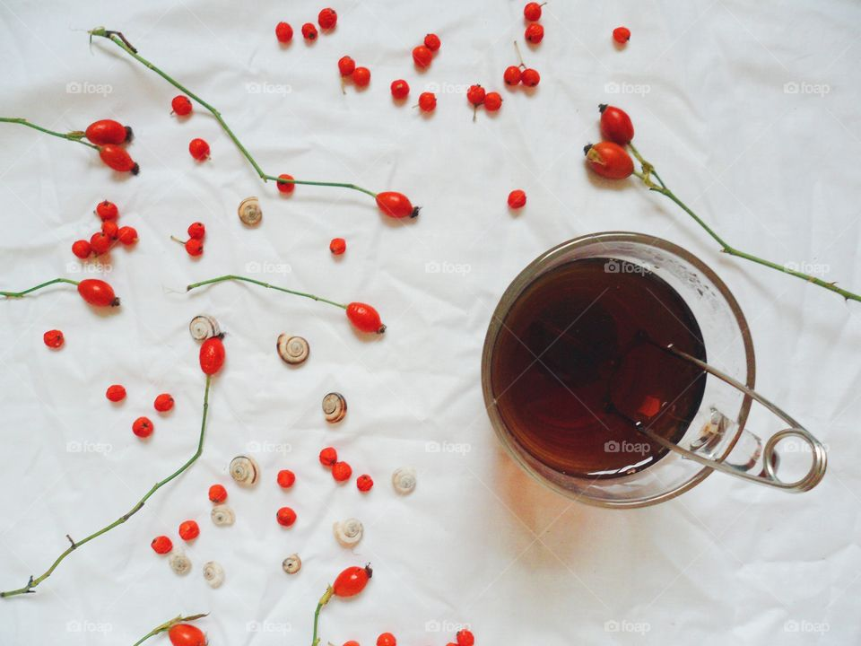 Cup of tea and berries wild rose