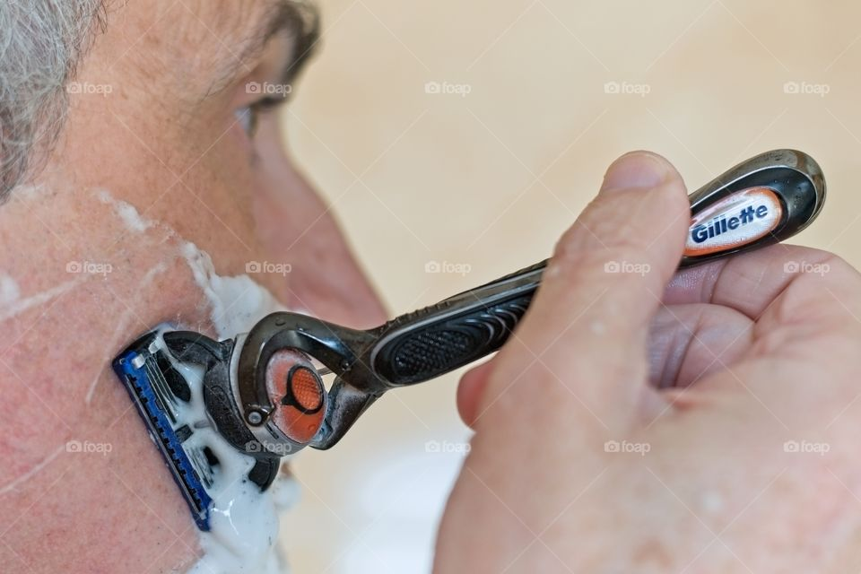 A man shaving in the bathroom