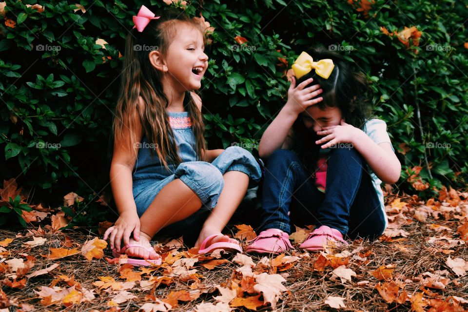 Two happy girls laughing outdoors