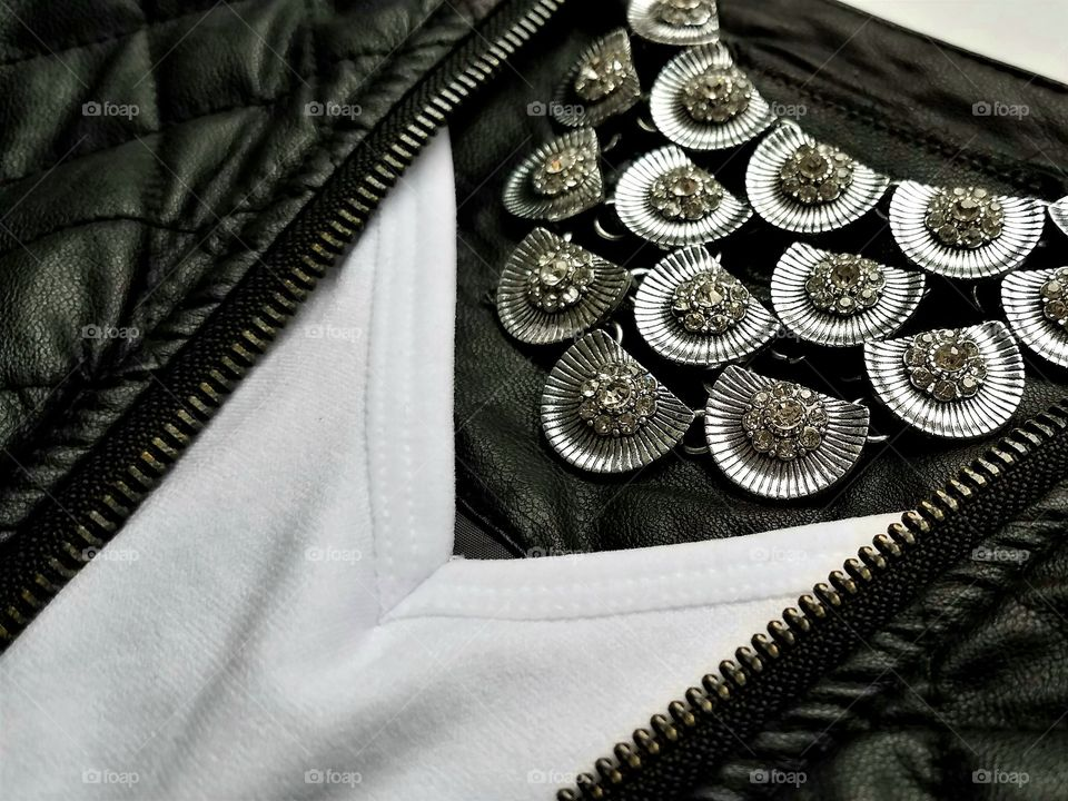Antique jewelry on leather jacket