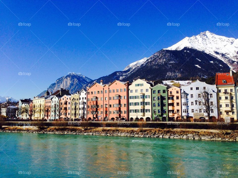 colorful houses riverside with snow mountains background