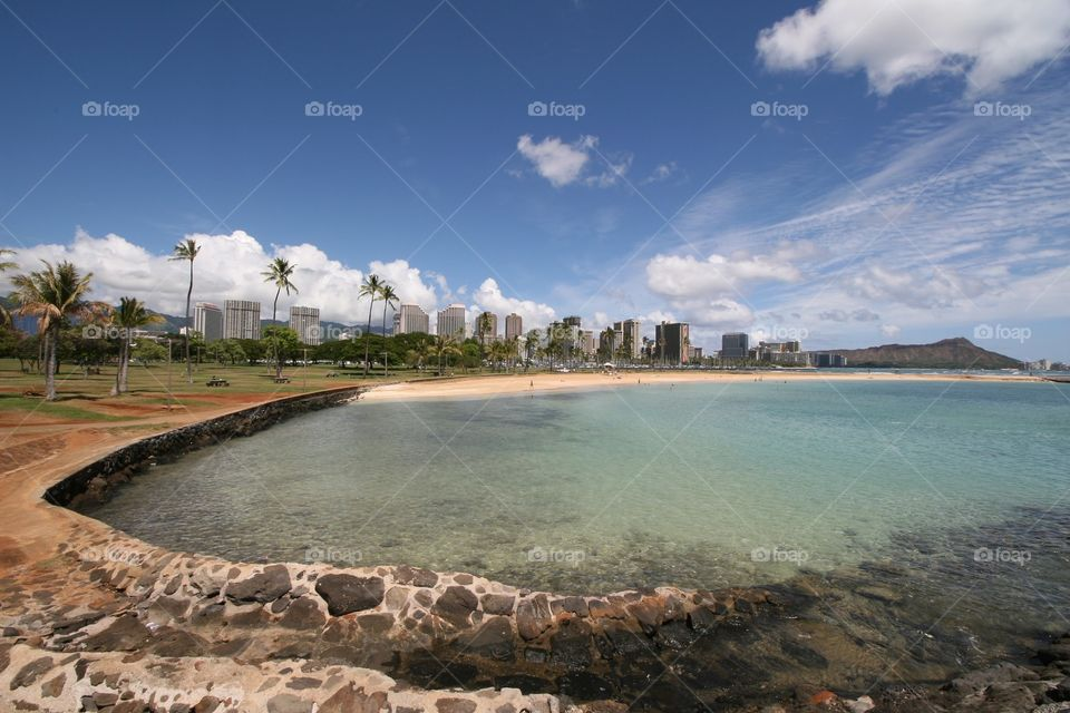 Ocean, Waikiki & Diamond Head . Strolling along the lagoon at Ala Moana Beach outside of Waikiki. Diamond head is in the distance.